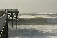 Surf rolls along the Crystal pier in Pacific Beach San Diego California, Wednesday, December 5 2007.  A large storm swell hit San Diego shores producing waves of  10 ft to 15 ft.