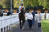 Winner of The Byerley Stud Handicap Stakes Ice Station Zebra (blue) ridden by Rob Hornby and trained by Ralph Beckett is led into the Winners enclosure during Horse Racing at Salisbury Racecourse on 1st October 2020