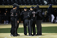 Louisville Cardinals head coach Dan McDonnell (3) has a discussion with the umpiring crew during the game against the Wake Forest Demon Deacons at David F. Couch Ballpark on March 6, 2020 in  Winston-Salem, North Carolina. The Cardinals defeated the Demon Deacons 4-1. (Brian Westerholt/Four Seam Images)