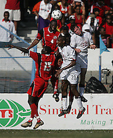 09 February, 2005. Trinidad and Tobago's Marvin Andrews (4) and Kenwyne Jones (15) collide with Brian McBride (20) and Eddie Pope (23) of the USMNT during the World Cup qualifier at Queen's Park Oval in Port of Spain, Trinidad and Tobago.  The USMNT defended Trinidad and Tobago 2-1.