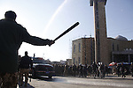 SULAIMANIYAH, IRAQ:  A policeman waves his baton while a truck sprays water at protesters...A second day of protests rocked the Kurdish Iraqi city of Sulaimaniyah.  Security forces used, batons, water canons, and live rounds.  At least 14 people were wounded...Photo by Ali Arkady