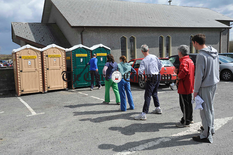 Competitors queue for the portaloo before taing part  at the Sonny Murphy memorial 10k road race in Kilnaboy. Photograph by John Kelly.