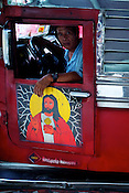 Photos of Mother Mary, Jesus and other religious Catholic messages are seen adorned on a Jeepney in Metro Manila in the Philippines. Photo: Sanjit Das