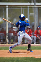 Toronto Blue Jays Dasan Brown (14) bats during an exhibition game against the Canada Junior National Team on March 8, 2020 at Baseball City in St. Petersburg, Florida.  (Mike Janes/Four Seam Images)