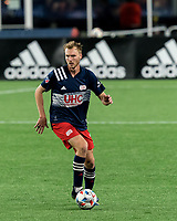 FOXBOROUGH, MA - APRIL 24: Henry Kessler #4 of New England Revolution brings the ball forward during a game between D.C. United and New England Revolution at Gillette Stadium on April 24, 2021 in Foxborough, Massachusetts.