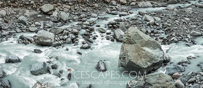 Rocky, wild and milky glacial Waiho river in Franz Josef Glacier valley, Westland Tai Poutini National Park, South Westland, West Coast, UNESCO World Heritage Area, New Zealand, NZ