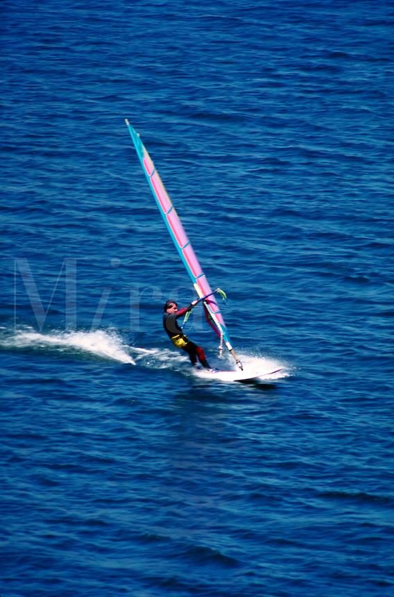 A windsurfer sails his board on Deer Creek Reservoir. water sports, sailing, boats Connotation - Speed. Utah, Deer Creek Reservoir.