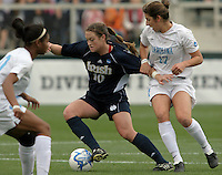 ND's Brittany Bock shields the ball against Yael Averbuch of UNC. UNC-Chapel Hill defeated Notre Dame 2-1 in the 2006 Women's College Cup at SAS Stadium in Cary, NC.