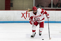 BOSTON, MA - JANUARY 04: Mackenna Parker #11 of Boston University brings the puck forward during a game between University of Maine and Boston University at Walter Brown Arena on January 04, 2020 in Boston, Massachusetts.