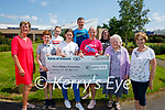 The Collins family from Tralee present the sum of €6,044.55 to the Kerry Hospice Foundation on Friday from climbing Brandon for Ann fundraiser which is going to the Kerry Hospice Foundation. Front l to r: Maura O'Sullivan, Jack Collins, Holly O'Brien, Kathleen and Mary Collins and Mary Shanahan. Back l to r: Ciara Rogers, John Collins and Sarah Higgins.