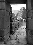 Wayna Picchu framed by a stone doorway at Machu Picchu in Peru. (Black & White)