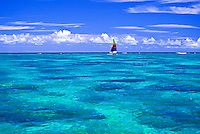 Colorful sailboat sailing in clear water near Lanikai beach