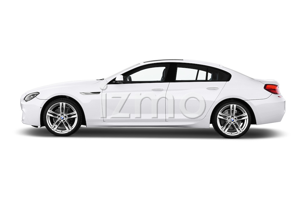 Car Driver side profile view of a 2016 BMW 6 Series 640i Gran Coupe 4 Door Sedan Side View