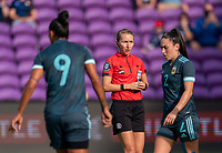 ORLANDO, FL - FEBRUARY 18: Referee Katja Koroleva talks to an Argentine player during a game between Argentina and Brazil at Exploria Stadium on February 18, 2021 in Orlando, Florida.