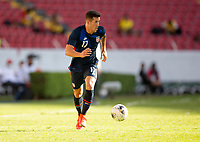 GUADALAJARA, MEXICO - MARCH 28: Aaron Herrera #17 of the United States dribbles with the ball during a game between Honduras and USMNT U-23 at Estadio Jalisco on March 28, 2021 in Guadalajara, Mexico.