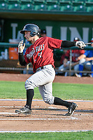 Nick Dini (51) of the Idaho Falls Chukars follows through on his swing against the Ogden Raptors during the Pacific Coast League game at Smith's Ballpark on August 29, 2016 in Salt Lake City, Utah. The Chukars defeated the Raptors 3-0. (Stephen Smith/Four Seam Images)