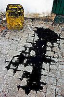Black oil puddle on the cobblestones, Malé, Maldives.