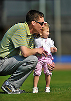 20 February 2011: Washington Nationals' Public Relations Director John Dever watches drills with his daughter Chelsea during Spring Training at the Carl Barger Baseball Complex in Viera, Florida. Mandatory Credit: Ed Wolfstein Photo