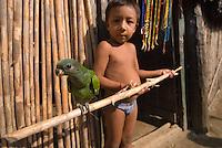 Young Kuna boy with pet parrot, Comarca De Kuna Yala, San Blas Islands, Panama