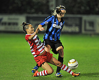 20131001 - VARSENARE , BELGIUM :  Antwerp Riana Nainggolan (left) pictured tackling Brugge's Tine De Caigny (right) during the female soccer match between Club Brugge Vrouwen and Royal Antwerp FC Ladies , of the fifth matchday in the BENELEAGUE competition. Tuesday 1 October 2013. PHOTO DAVID CATRY