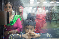 A Nepali boy waits for his relatives at Kathmandu International Airport, Nepal.