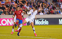 HOUSTON, TX - FEBRUARY 03: Fabiola Sanchez #5 of Costa Rica battle for a ball with Christen Press #20 of the United States during a game between Costa Rica and USWNT at BBVA Stadium on February 03, 2020 in Houston, Texas.