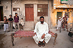 A local man sits with his family outside his home in Rawalpindi ten kilometres from Islamabad. The capital of Pakistan has been in turmoil  recently as the Government faces political upheaval and the ever present threat of the Taliban.