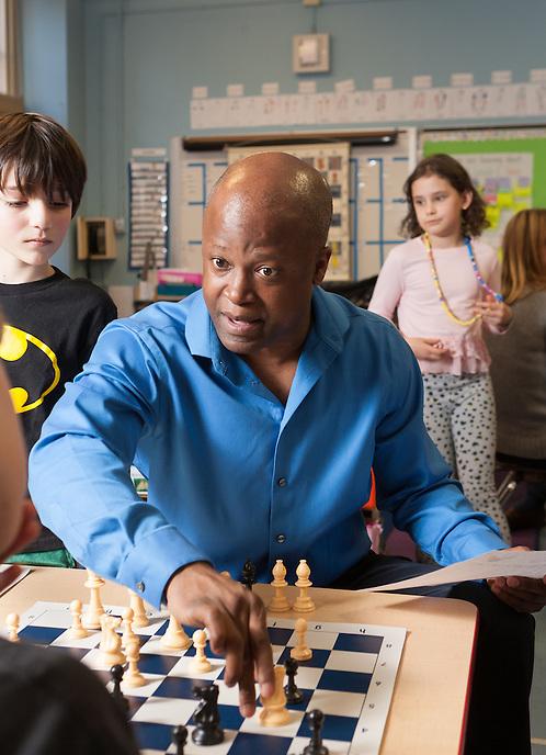 Grandmaster Maurice Ashley at kids chess tournament at PS 6, 45 East 81st St. photo by Ari Mintz.  3/9/2014.