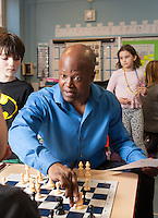 Grandmaster Maurice Ashley at kids chess tournament at PS 6, 45 East 81st St. photo by Ari Mintz.  3/9/2014.