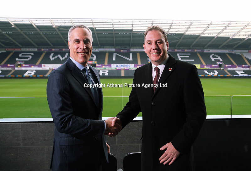 (L-R) Chief Operating Officer for Swansea City FC Chris Pearlman with Leader of Swansea County Council Rob Stewart, at the Liberty Stadium, Swansea, Wales, UK. Re: Swansea City FC has agreed to lease its Liberty Stadium home after securing a deal with Swansea City and County council.<br /> The Swans will pay the authority £300,000 a year for 37 years, give it a cut of stadium sponsorship revenue and build 3G pitches in the city.