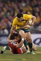 MELBOURNE, 29 JUNE 2013 - Adam ASHLEY-COOPER of the Wallabies is tackled by Sam WARBURTON, Captain of the Lions during the Second Test match between the Australian Wallabies and the British & Irish Lions at Etihad Stadium on 29 June 2013 in Melbourne, Australia. (Photo Sydney Low / sydlow.com)