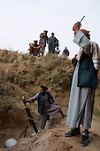 Khogebha Hoddin, Northern Afghanistan <br /> October 2001<br /> <br /> The Northern Alliance fire mortar shells at Taliban position on the front line near Khogebha Hoddin.
