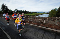 09 SEP 2011 - CHESTER, GBR - Runners cross the medieval bridge at Farndon during the MBNA Chester Marathon .(PHOTO (C) NIGEL FARROW)