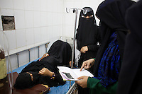 Students at the Health Science Institute in Houdeidah attend to a patient. Many of the young women at this college come from the surrounding countryside and the plan is that they will return to work in their villages where there is one midwife for every 8,000 people.  ..