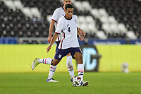 SWANSEA, WALES - NOVEMBER 12: Tyler Adams #4 of the United States passes off the ball during a game between Wales and USMNT at Liberty Stadium on November 12, 2020 in Swansea, Wales.