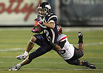 Nevada's Richy Turner (12) tries to break a tackle from San Diego State's King Holder (35) during the first half of an NCAA college football game in Reno, Nev., on Saturday, Oct. 20, 2012. Nevada is leading San Diego State 10-6 going into the second half.(AP Photo/Cathleen Allison)