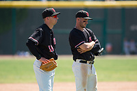 Visalia Rawhide third baseman Drew Ellis (10) and second baseman Adam Walton (2) talk through a pitching change during a California League game against the Stockton Ports at Visalia Recreation Ballpark on May 9, 2018 in Visalia, California. Stockton defeated Visalia 4-2. (Zachary Lucy/Four Seam Images)