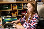 Education Elementary Grade 5 girl using laptop computer