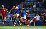 Glasgow 2014 Commonwealth Games<br /> Will Harries dives in to tackle Lio Lolo.<br /> Wales v Samoa<br /> Ibrox Stadium<br /> <br /> 26.07.14<br /> ©Steve Pope-SPORTINGWALES