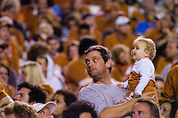 04 November 2006: Eleven-month-old Bailey Falk and her father Tony watch the Texas Longhorns during the Longhorns 36-10 victory over the Oklahoma State University Cowboys at Darrel K Royal Memorial Stadium in Austin, Texas.