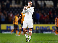 Jonjo Shelvey of Swansea City thanks the fans at the end of the game during the Capital One Cup match between Hull City and Swansea City played at the Kingston Communications Stadium, Hull