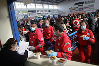 Pictured: red Cross personnel assist with the hundreds of migrants in Ierapetra basketball arena. Friday 28 November 2014<br />