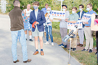 With an American flag bandana in his back pocket (used as an anti-COVID facemask when not in front of cameras), John Pence, nephew of Vice President Mike Pence and a 2020 Trump campaign senior advisor, speaks to Trump campaign volunteers and workers holding Trump/Pence campaign signs outside the office of the New Hampshire Republican State Committee in Concord, New Hampshire, on Wed., Sept. 16, 2020. John Pence spoke to the crowd about the importance of their get out the vote efforts in securing a reelection victory for Donald Trump and Mike Pence.