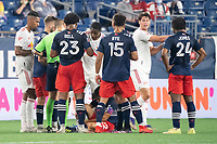 FOXBOROUGH, MA - MAY 22: Referee issues a second yellow card to Andres Reyes #4 of New York Red Bulls after a foul during a game between New York Red Bulls and New England Revolution at Gillette Stadium on May 22, 2021 in Foxborough, Massachusetts.