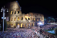 Colosseum in Rome;Pope Francis holds the wooden cross during the Via Crucis (Way of the Cross) torchlight procession on Good Friday in front of the Colosseum in Rome.April 18, 2014