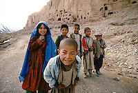 Kids near the cliff of the Giant Bamiyan Buddha in 1996. Hazarajat, Afghanistan.