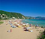 Greece, Corfu, Glyfada (Glifada): Beach Scene | Griechenland, Korfu, Glyfada (Glifada): Strand und Urlaubsort an der Westkueste