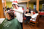 """TORRINGTON, CT-121917JS03---Torrington resident Dawn Veretto gets her hair cut and styled by Terri Hendrix, owner of Beauty and the Barber Tuesday at Jospeh's House, a Christ-Centered community ministry in Torrington. This is the second year Hendrix has volunteered her time and skills for the program """"Christmas Cuts"""", which gives haircuts to those in need. Hendrix said she just loves to give back to the community. <br /> Jim Shannon Republican-American"""