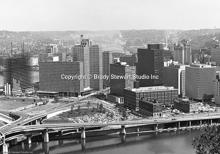 Pittsburgh PA:  View of Pittsburgh's Gateway Center with the new Gateway Towers under construction.  From left to right; Hilton Hotel, Gateway 1, 2 & 3, Pennsylvania State Office Building, Gateway 4, Pittsburgh Press building, Bell Telephone Building, and IBM Building.