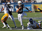 Nevada quarterback Tyler Stewart (15) runs against San Jose State during the first half of an NCAA college football game in Reno, Nev., on Saturday, Nov. 14, 2015. (AP Photo/Cathleen Allison)